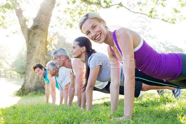 Happy athletic group training  Stock photo © wavebreak_media