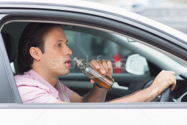 Homem potável álcool condução carro estrada Foto stock © wavebreak_media