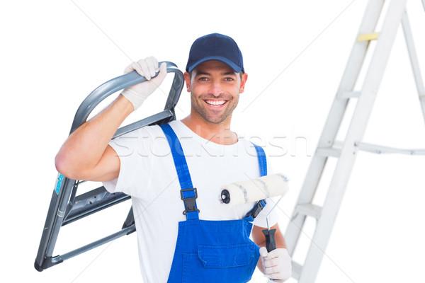 Feliz handyman cadeira pintar branco retrato Foto stock © wavebreak_media