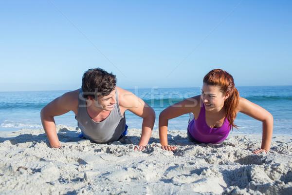 Happy couple doing push ups together Stock photo © wavebreak_media