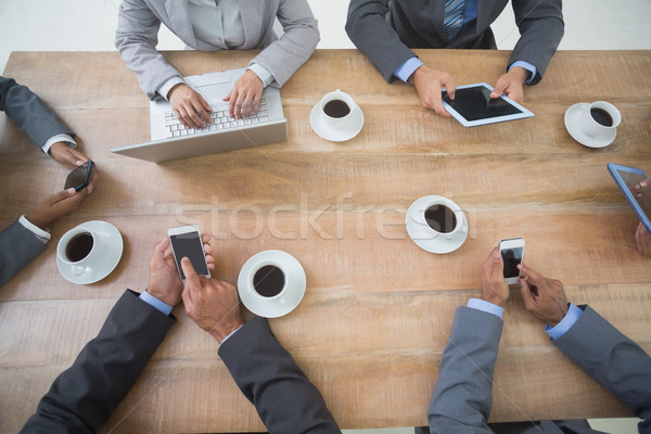 Business people in meeting with new technologies Stock photo © wavebreak_media