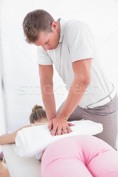 Physiotherapist doing back massage  Stock photo © wavebreak_media