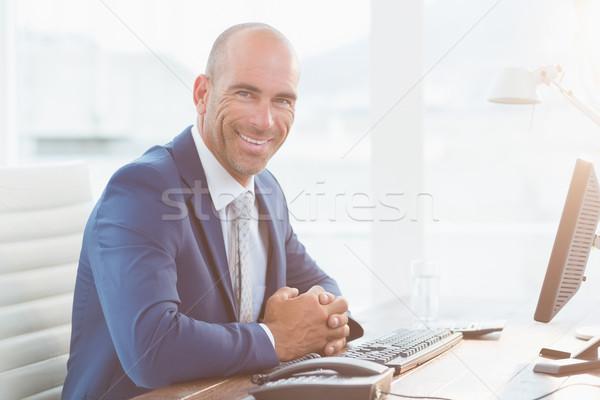 Smiling businessman looking at camera Stock photo © wavebreak_media