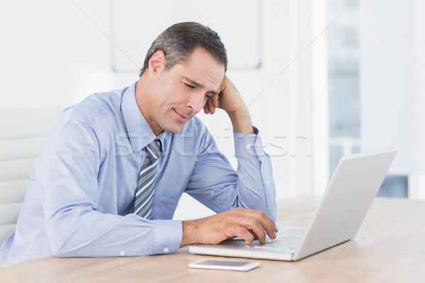 Frustrated businessman working with his computer  Stock photo © wavebreak_media