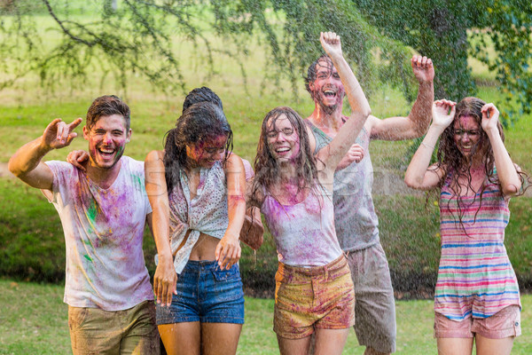 Happy friends covered in powder paint Stock photo © wavebreak_media