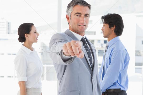 Businessman pointing to the camera Stock photo © wavebreak_media