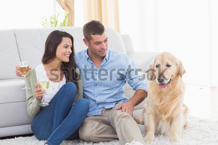 Cute siblings playing with dog with their parent on the sofa Stock photo © wavebreak_media