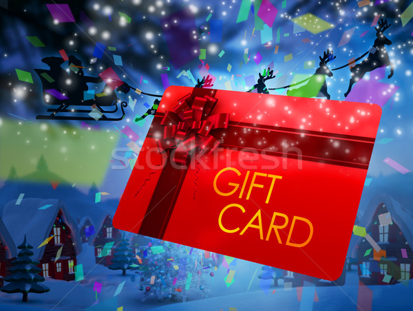 Composite image of santa flying his sleigh behind gift card Stock photo © wavebreak_media