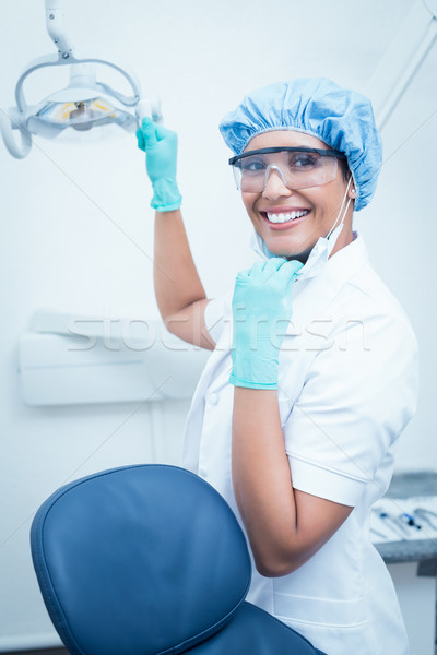 Female dentist wearing surgical cap and safety glasses Stock photo © wavebreak_media