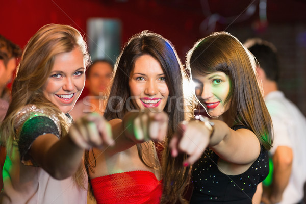 Feliz amigos indicação câmera boate bar Foto stock © wavebreak_media