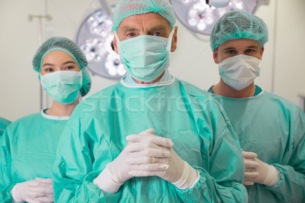Medical student and lecturer looking at camera in scrubs Stock photo © wavebreak_media