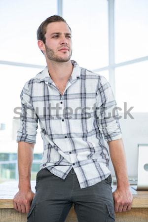 Geeky hipster standing straight with forced smile Stock photo © wavebreak_media