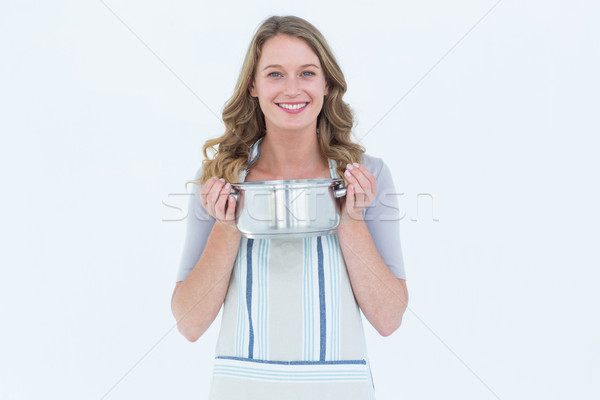 Smiling woman holding saucepan  Stock photo © wavebreak_media