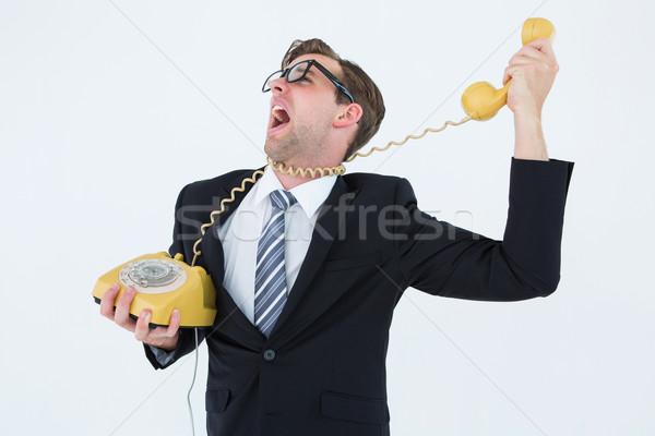 Biznesmen telefonu przewód biały działalności telefon Zdjęcia stock © wavebreak_media