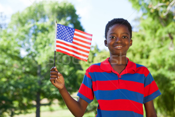 Little boy waving american flag Stock photo © wavebreak_media