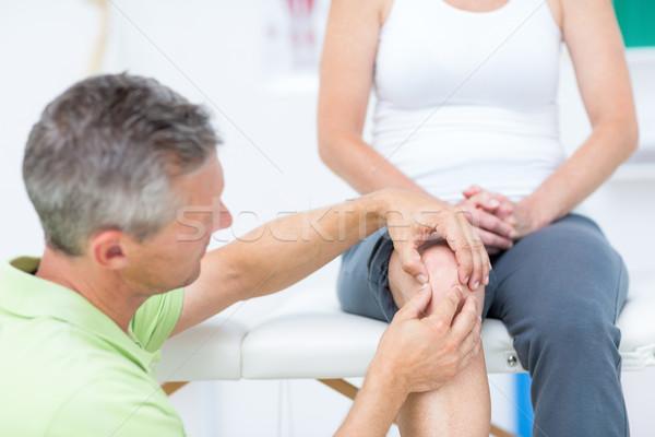 Doctor examining his patients knee Stock photo © wavebreak_media