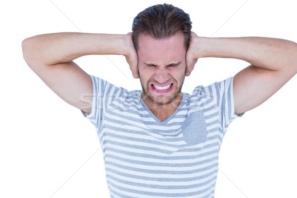 Guapo casual hombre gritando mano orejas Foto stock © wavebreak_media