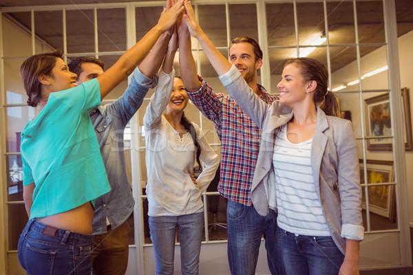 Creative business team waving their hands Stock photo © wavebreak_media