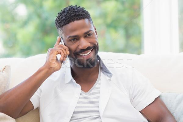 Boldog férfi telefon otthon nappali ház Stock fotó © wavebreak_media