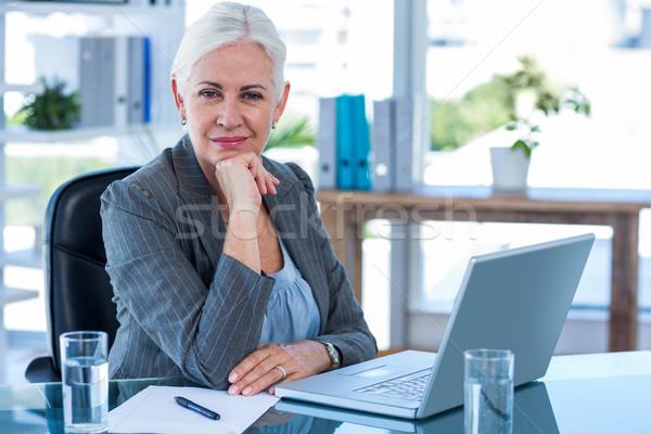 Happy businesswoman looking at camera  Stock photo © wavebreak_media