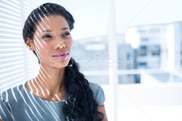 Thoughtful businesswoman standing in the office Stock photo © wavebreak_media