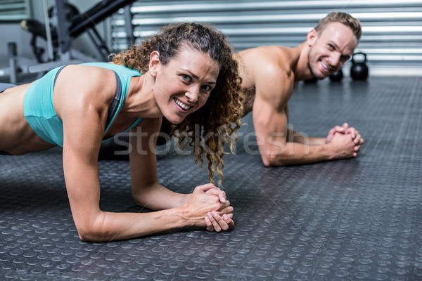 Muscular couple doing planking exercises Stock photo © wavebreak_media
