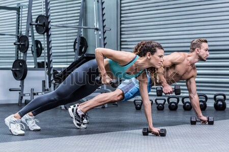 Muscular man doing push-ups with kettlebells Stock photo © wavebreak_media