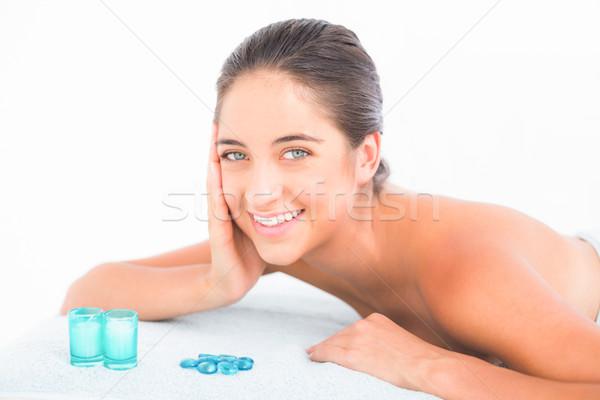 Pretty brunette lying on massage table Stock photo © wavebreak_media