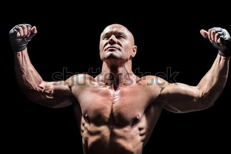 Strong bodybuilder with arms up Stock photo © wavebreak_media