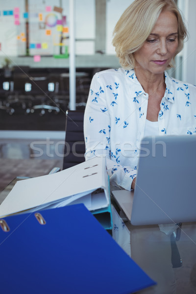 Focused businesswoman working on laptop at office Stock photo © wavebreak_media