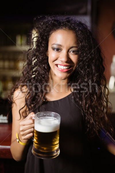 Portrait of smiling woman with beer glass Stock photo © wavebreak_media