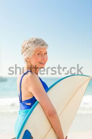 Vista laterale uomo seduta tavola da surf cielo acqua Foto d'archivio © wavebreak_media