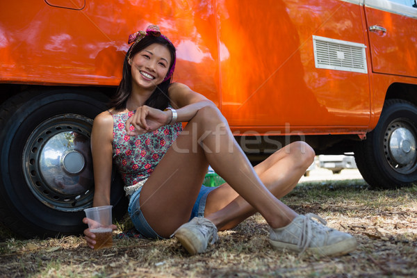 Woman sitting with a glass of beer in the park Stock photo © wavebreak_media