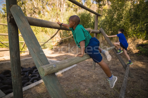 Boys exercising on outdoor equipment during obstacle course Stock photo © wavebreak_media