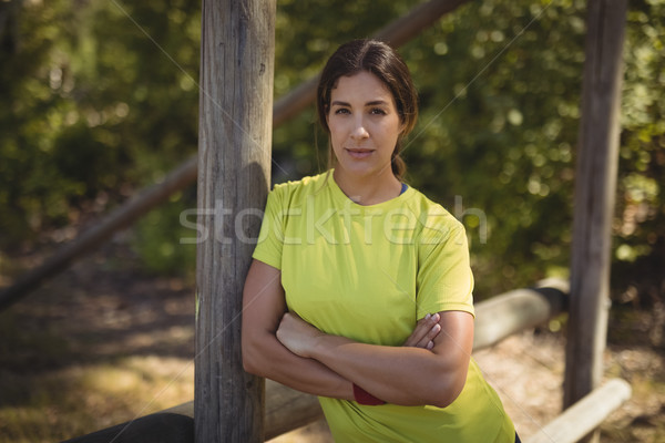 Portrait of confident woman leaning with arms crossed during obstacle course Stock photo © wavebreak_media