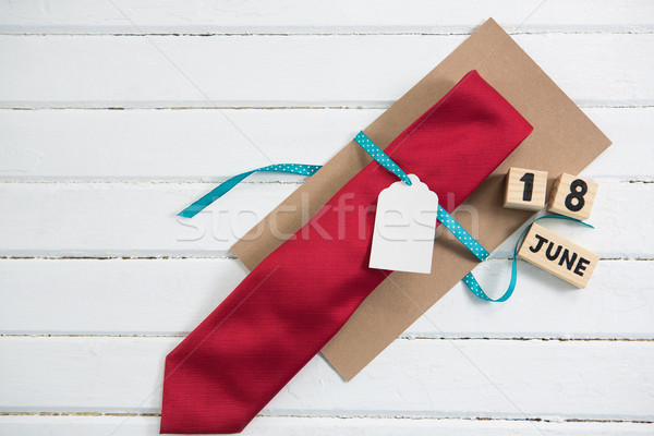 Overhead view of necktie gift by calender on table Stock photo © wavebreak_media