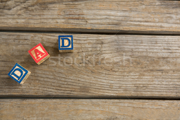 Overhead view of cube shapes with text dad on table Stock photo © wavebreak_media