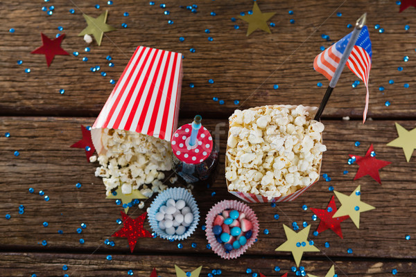 Popcorn, sweet food and cold drink decorated with 4th july theme Stock photo © wavebreak_media