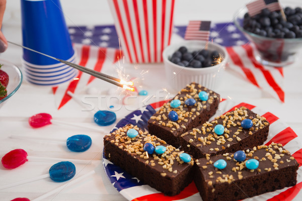Close-up of sweet food and burning crackers decorated with 4th july theme Stock photo © wavebreak_media