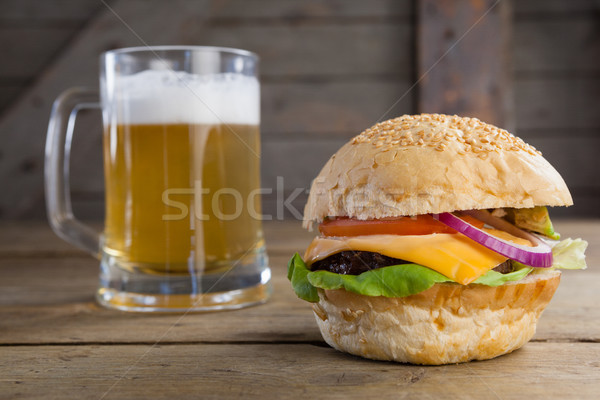 Burger with glass of beer on wooden table Stock photo © wavebreak_media