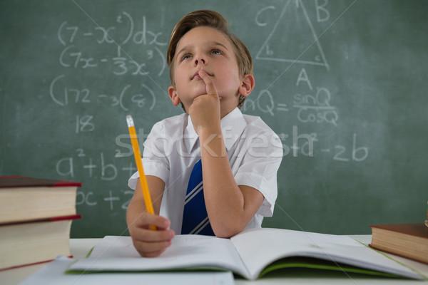 Iskolás fiú házi feladat osztályterem figyelmes férfi gyermek Stock fotó © wavebreak_media