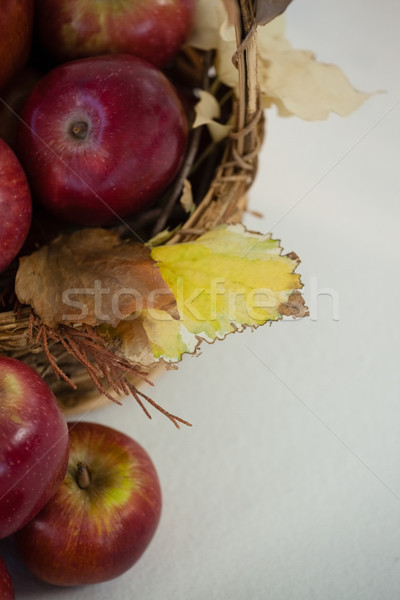 Czerwony jabłka wiklina koszyka biały Zdjęcia stock © wavebreak_media