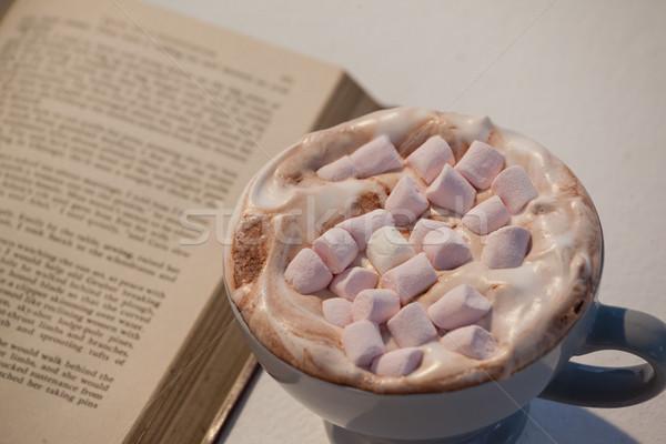 Tasse cappuccino livre ouvert blanche livre café Photo stock © wavebreak_media