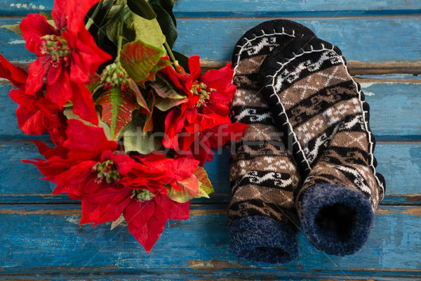 Overhead view of poinsettia by socks on wooden table Stock photo © wavebreak_media