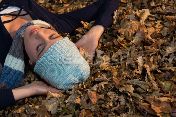 High angle view of woman lying on dry leaves during autumn Stock photo © wavebreak_media