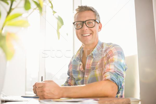 Mosolyog lezser designer dolgozik portré iroda Stock fotó © wavebreak_media