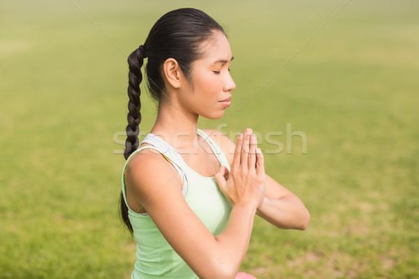 Peaceful sporty woman doing yoga Stock photo © wavebreak_media
