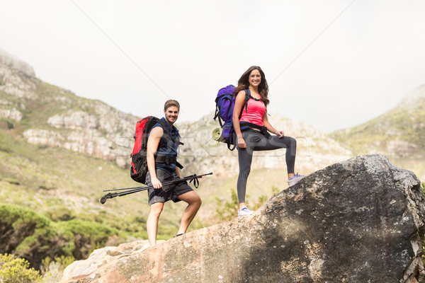 Stock photo: Young happy joggers standing on rock