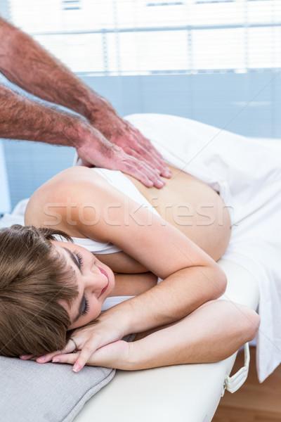 Mannelijke masseur zwangere vrouw massage centrum Stockfoto © wavebreak_media