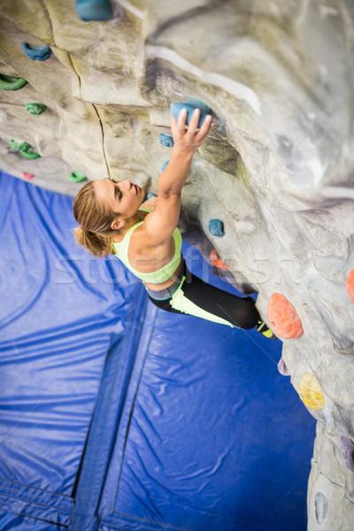Uygun kadın kaya tırmanışı spor salonu duvar Stok fotoğraf © wavebreak_media